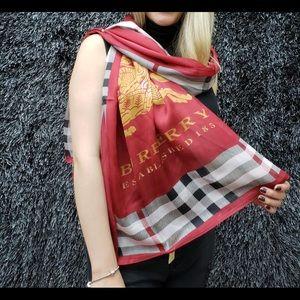 Burberry scarf Like New. 100% silk. Retail 250.00